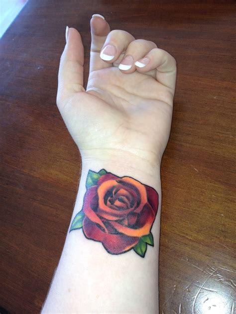 flowers wrist tattoos