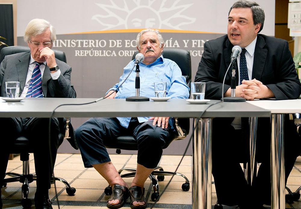 Uruguay President Jose Mujica, center, sits between his vice president, Danilo Astori, left, and his finance minister, Mario Bergara. (Matilde Campodonico/ AP)