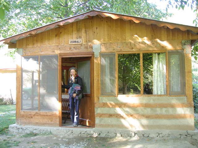 Me exiting one of the Colonel's chalets (aka the Hindu Kush Heights hotel's Mastuj branch)