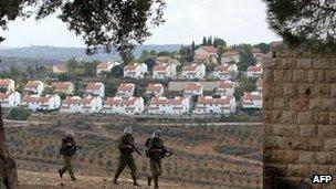 Israeli soldiers patrol near a Jewish settlement