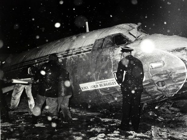 "Rescue workers pictured in a snowstorm at the wreckage of the B,E,A, Elizabethan airliner G-ALZU ""Lord Burghley"" after the crash at Munich in which 23 people died, 8 being Manchester United footballers"