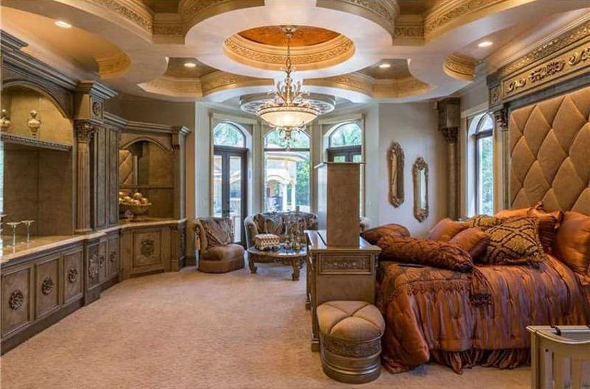 luxury baroque style master bedroom with elegant coffered ceiling with center cupola and tufted bed frame with gold inlay