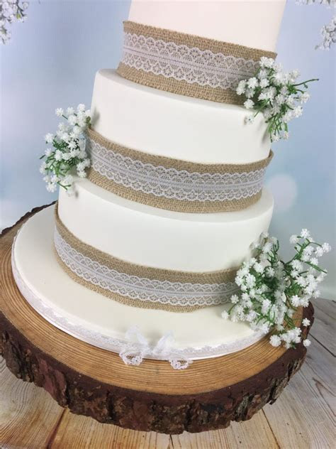 Hessian and lace wedding cake with bride and groom topper
