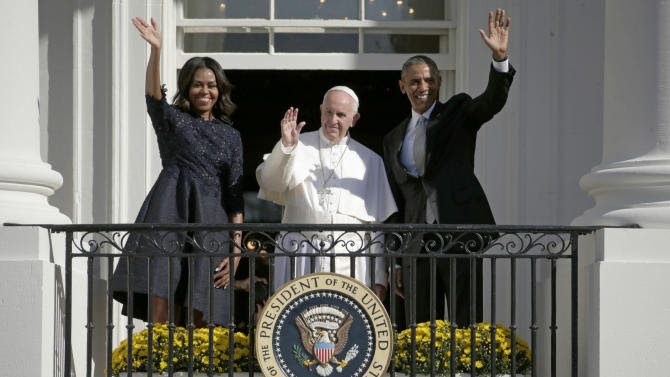 President Barack Obama, first lady Michelle Obama and Pope Francis wave to the crowd on the South Lawn from the Truman Balcony of the White House in Washington, Wednesday, Sept. 23, 2015, during a state arrival ceremony. (AP Photo/Pablo Martinez Monsivais)
