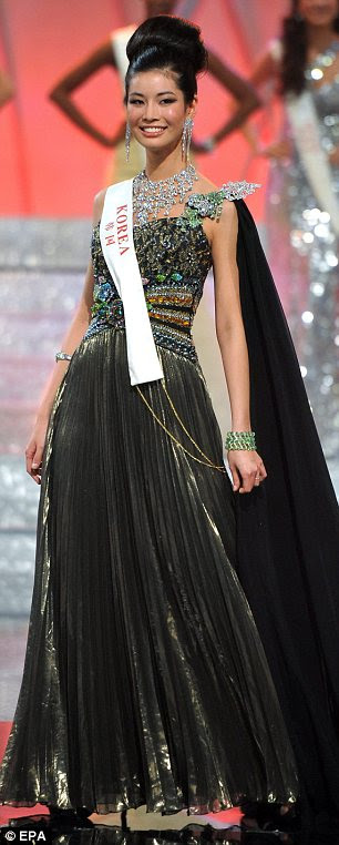 Miss Korea, Kyung Min Do, showcases her eveningwear during last night's finals