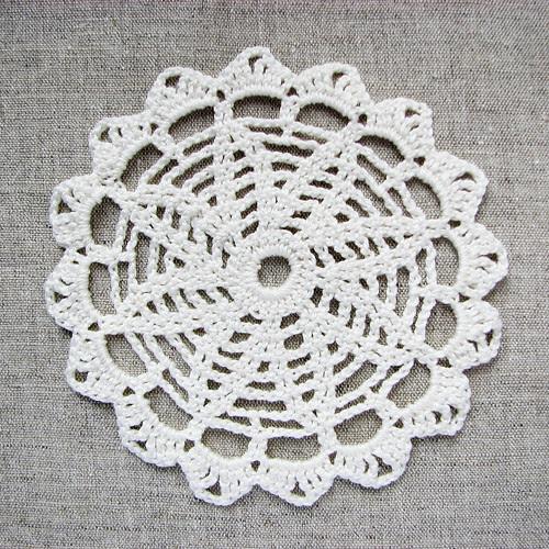 crocheted doily as coaster