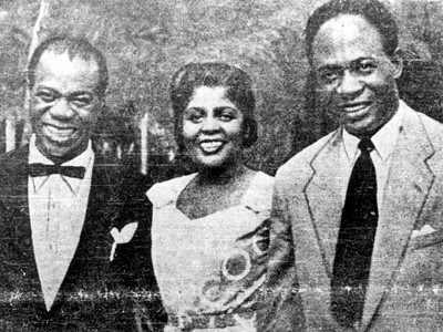 Jazz musician Louis Armstrong with his wife Lucille and Prime Minister Kwame Nkrumah of the Gold Coast. This photograph was taken in 1956 during Armstrong's goodwill visit on the eve of Ghana's independence. by Pan-African News Wire File Photos