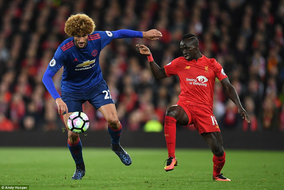 Marouane Fellaini, restored to the United starting XI for the first time since the defeat at Watford, battles with Sadio Mane
