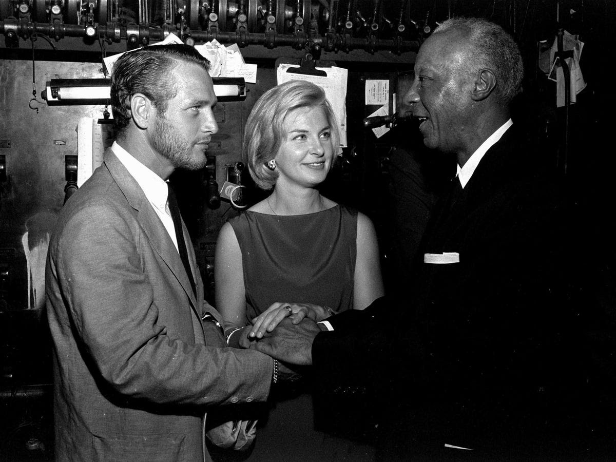 Celebrities also played a crucial role in financing the March on Washington. A. Philip Randolph, right, the director of the March on Washington, shakes hands with actor Paul Newman at a benefit performance at Harlem's Apollo Theater. Stars performed a four-hour, post-midnight show that night that raised $30,000 only four days before the march began.