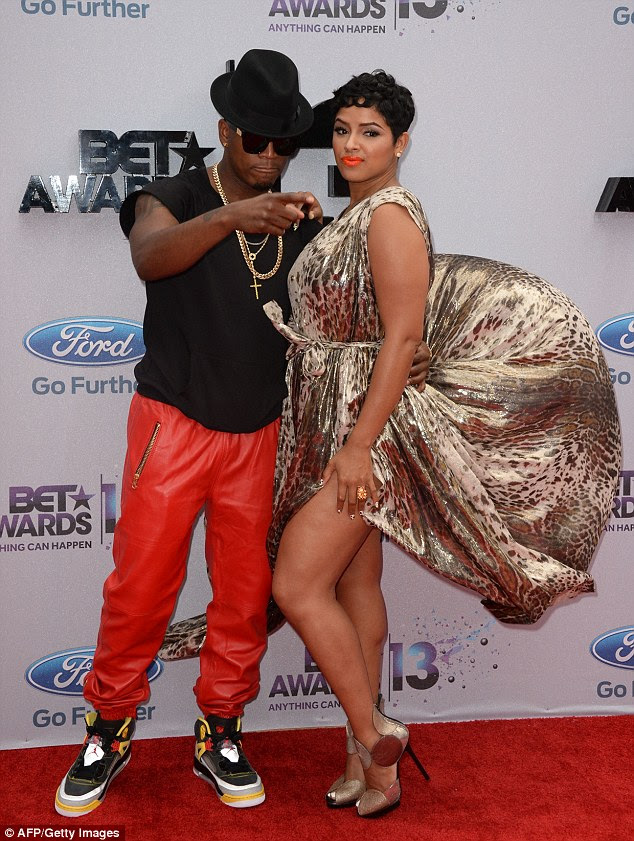 She's not the only one: Singer Ne-Yo's fiancé Monyetta Shaw also lost control of her gown