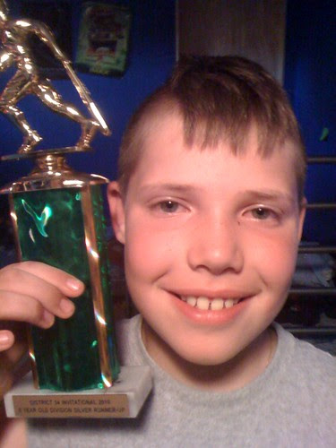 D with trophy