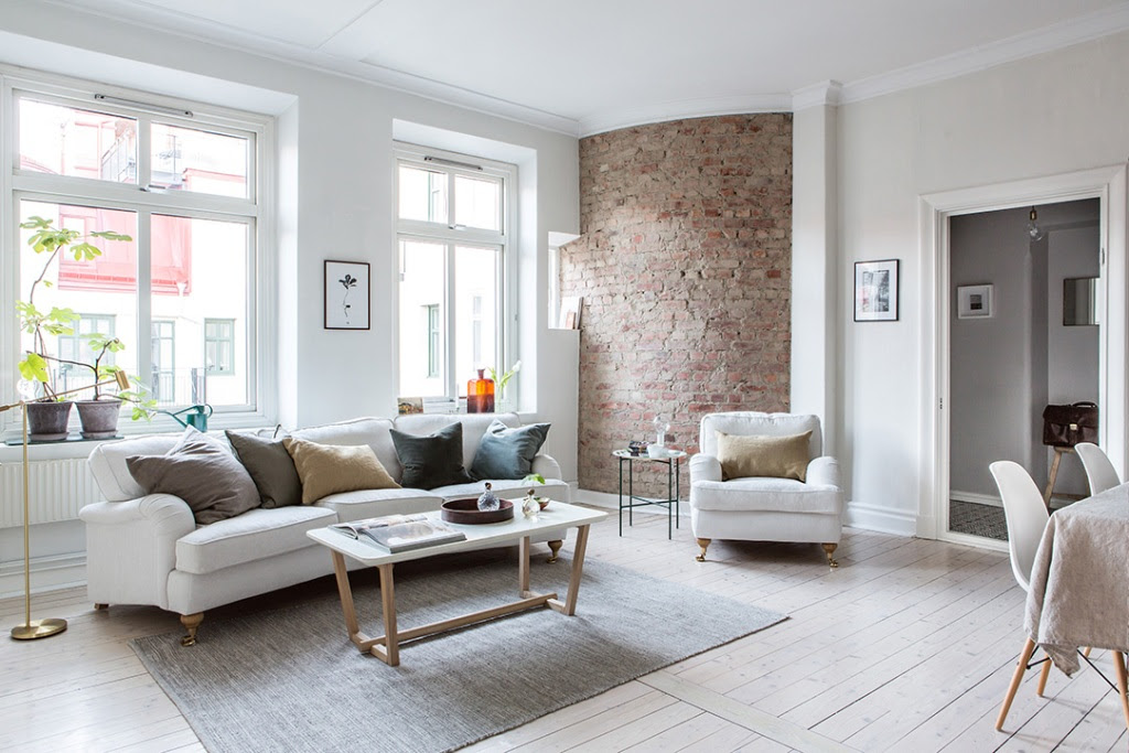 A Bright Interior Design Apartment With One Round Brick Wall