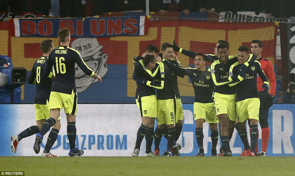 Arsenal striker Lucas Perez is given a celebratory hug from fellow summer signing Granit Xhaka after scoring his first goal