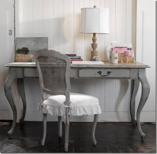 This shabby chic antique grey desk is well paired with a cane back chair. The seat cushion adds a touch of whimsy. Used here as a desk, but imagine it paired with a leaning desktop mirror for the perfect vanity!