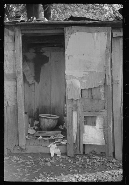 """Privy in Negro section """"Paradise Alley."""" Only one for sixty people. Charleston, West Virginia"""