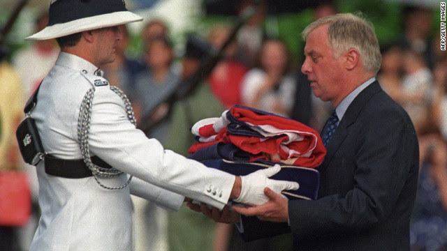 Chris Patten, the 28th and last governor of British colonial Hong Kong, receives the Union Jack flag after it was lowered for the last time at Government House on June 30, 1997.