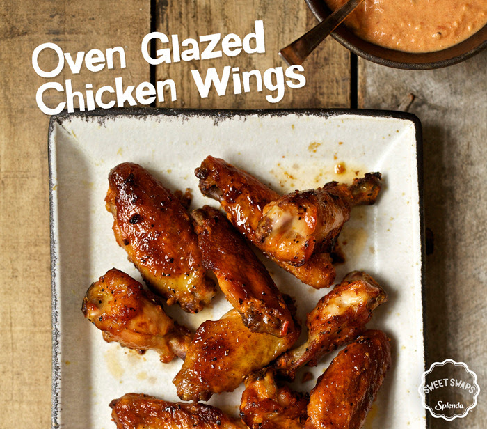 This holiday season, try swapping out delivery for something homemade. Fill your home with the aromatic scents of these Oven Glazed Chicken Wings that use SPLENDA®Sugar Blend.[[MORE]]Oven Glazed Chicken Wings RecipeServing Size: 5 oz.Servings Per Recipe: 3INGREDIENTS3 tablespoons butter1 tablespoon garlic, chopped¼ cup hot sauce¼ cup tomato paste3 tablespoons SPLENDA®Sugar Blend2 tablespoons soy sauce1 tablespoon cider vinegar¼ teaspoon liquid smoke¼ teaspoon cayenne pepper1 ½ pounds chicken wings, cut into three pieces, discard tipsDIRECTIONSPreheat oven to 375ºFIn a medium sauce pan, melt butter with garlic and simmer for 1 minute.Add the rest of the ingredients (except chicken) and bring to a simmer then cool.In a medium sized mixing bowl, add the chicken wings and sauce, and stir to coat.Spray a baking sheet with vegetable spray.Place chicken wings on baking sheet in a single layer.Bake for 30 minutes in preheated oven, or until juices run clear.Nutritional Information