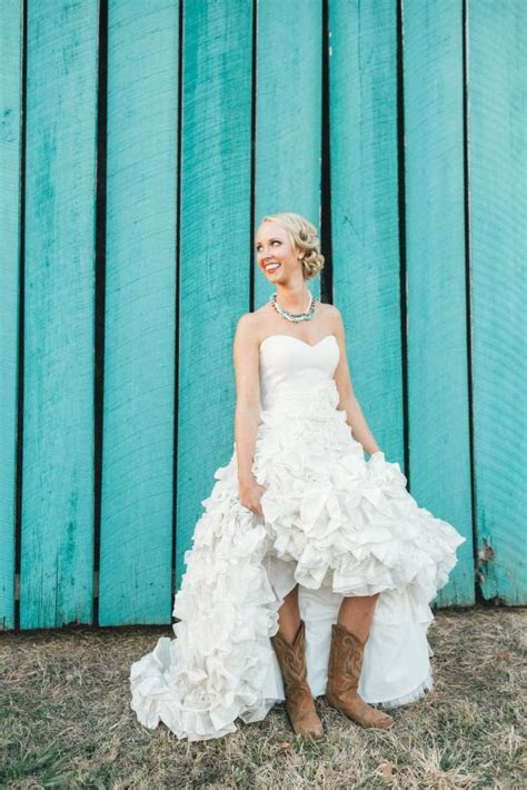 Country ruffled wedding dress with cowgirl boots. How cute