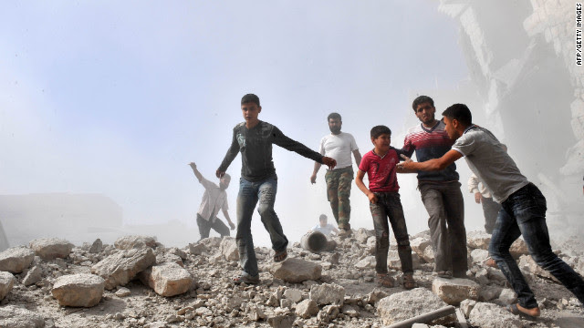 Syria youths react following an airstrike by Syrian government forces in Maaret al-Numaan on Thursday, October 18. Syrian regime warplanes launched a new wave of strikes on the northwestern town, seized by rebels last week, an AFP correspondent reported. Click through these photos from October, and <a href='http://www.cnn.com/2012/10/09/world/gallery/syria-unrest-september/index.html' target='_blank'>see September photos of the conflict.</a>