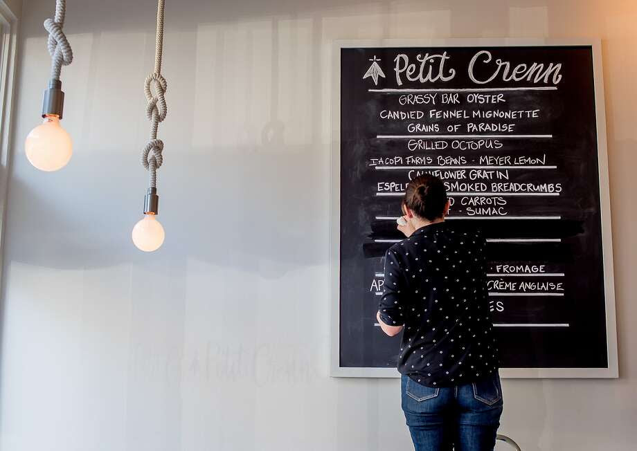 At Petit Crenn on Hayes Street in S.F., the menu is written on chalkboards. Photo: John Storey, Special To The Chronicle