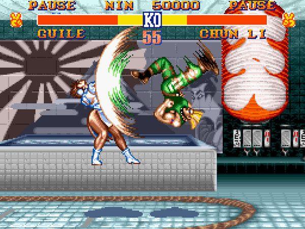 Guile Flash Kicks Chun-Li in STREET FIGHTER II.