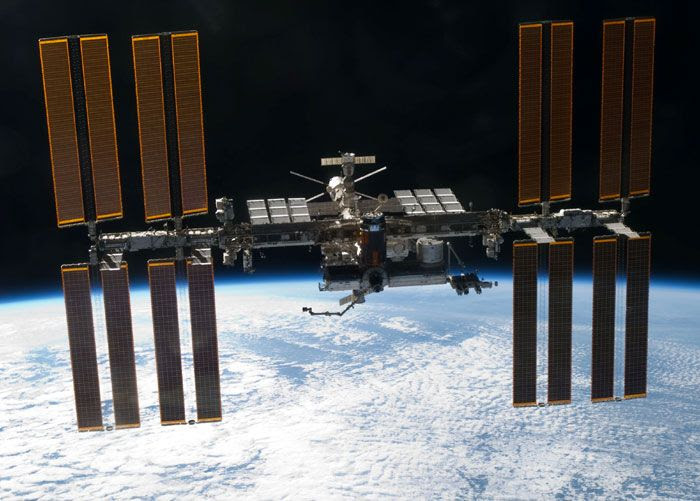 The International Space Station as seen from space shuttle Discovery after she undocked from the orbital outpost on March 7, 2011.