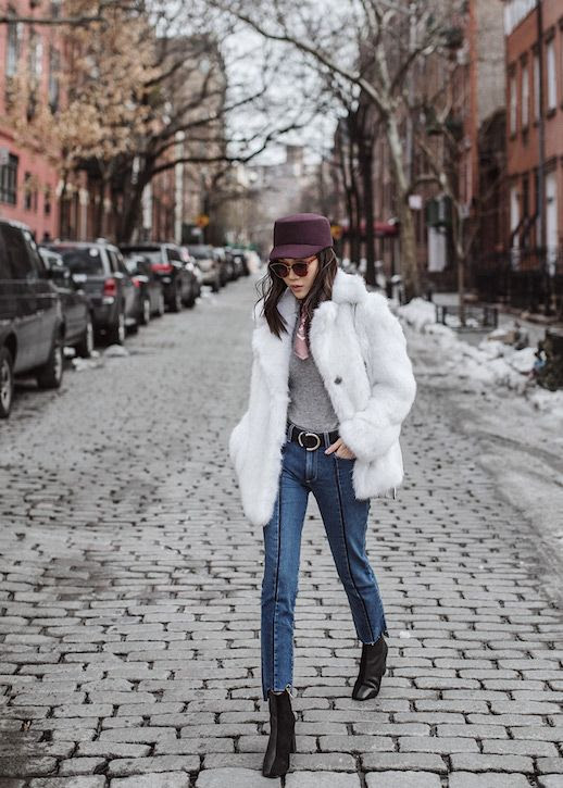Le Fashion Blog White Fluffy Fur Coat Gray Sweater Stripe Raw Hem Jeans Black Heeled Booties Via Tsangtastic