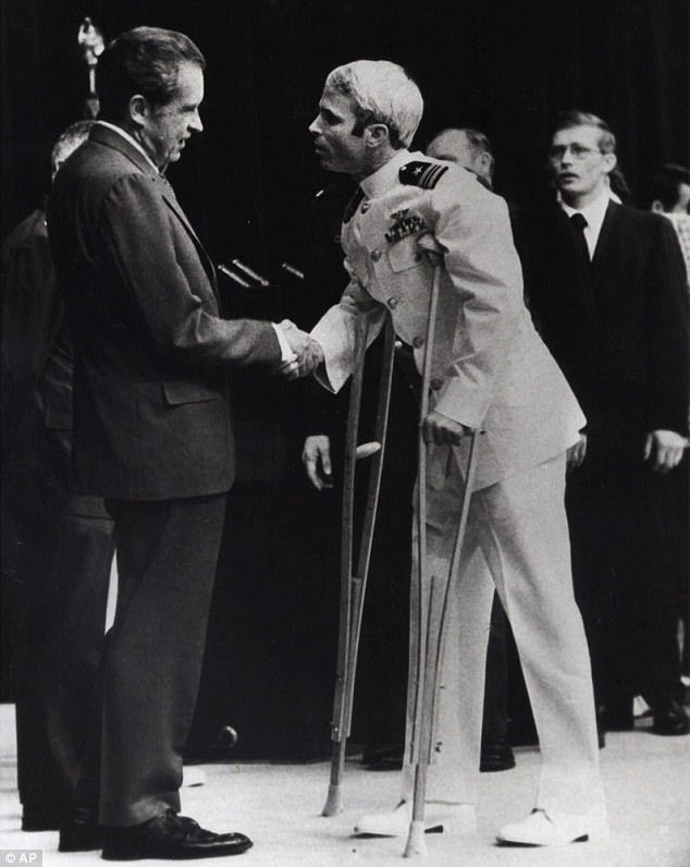 Fellow POWs at the Hanoi Hilton helped him survive. McCain is seen above shaking hands with then-President Richard Nixon in September 1973, just months after his release from Vietnamese captivity
