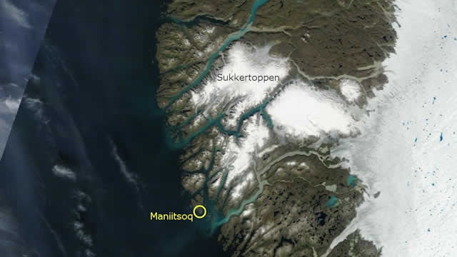 """Via the Danish Meteorological Institute: """"Satellite photo of the area around Maniitsoq and Sugar Loaf Mountain on Tuesday 30 July 2013. Photo from NASA's Terra satellite."""""""