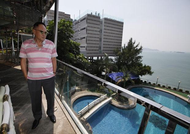 Cecil Chao Sze-tsung tenta arrumar marido para a filha Gigi Chao. Foto: Kin Cheung / AP
