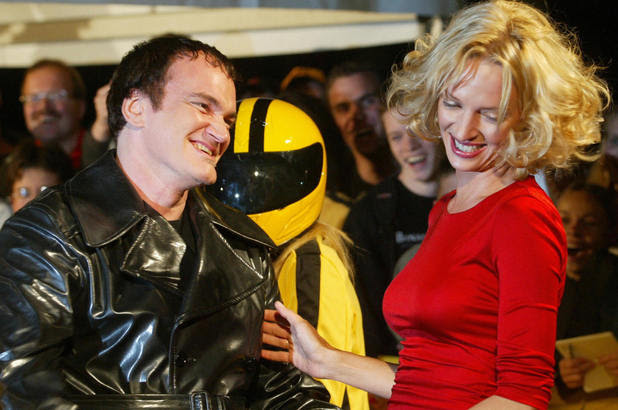 US actress Uma Thurman (R) and director Quentin Tarantino arrive for the German premiere of Tarantino's film 'Kill Bill: Volume 1' in which Thurman stars, in Berlin 01 October 2003. AFP PHOTO DDP/JOHANNES EISELE GERMANY OUT (Photo credit should read JOHANNES EISELE/AFP/Getty Images)