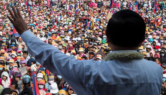 Cambodia National Rescue Party acting president Kem Sokha addresses a mass of garment workers at Phnom Penh's Freedom Park during a political rally in 2013.