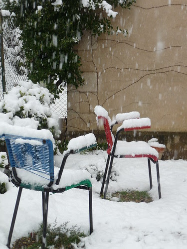 Snow covered chairs