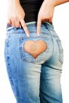 11372899-girl-in-jeans-with-heart-shaped-hole-on-the-buttock-indicates-the-two-fingers