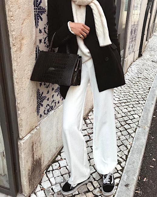 Le Fashion Blog Pajama Dressing Winter Style Black Peacoat Cableknit Cream Scarf Cream Sweater Cream Wool Trousers Croc Square Tote Bag Black Vans Via @deborabrosa