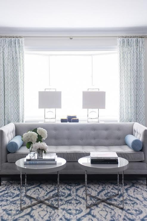 Blue And Gray Living Room Features A Gray Tufted High Back
