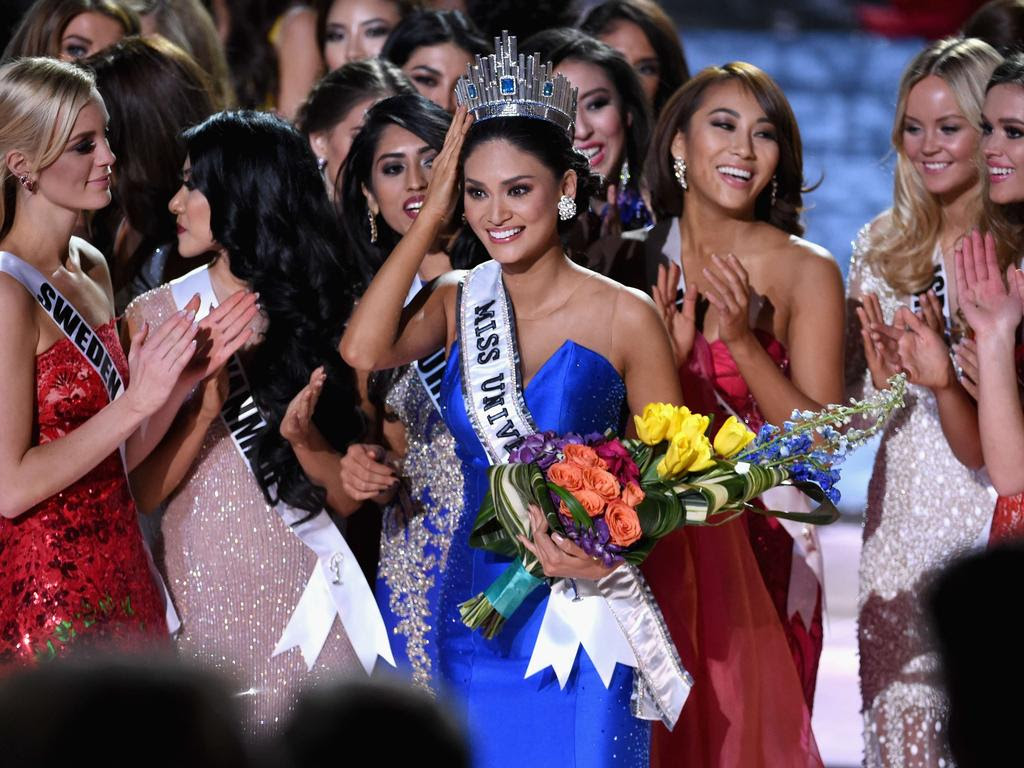 Miss Philippines 2015, Pia Alonzo Wurtzbach who was mistakenly named as First Runner-up reacts with other contestants after being named the 2015 Miss Universe during the 2015 Miss Universe Pageant. Picture: AFP