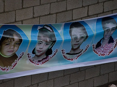 Faces of Gaza victims. (Photo: Johnny Barber)