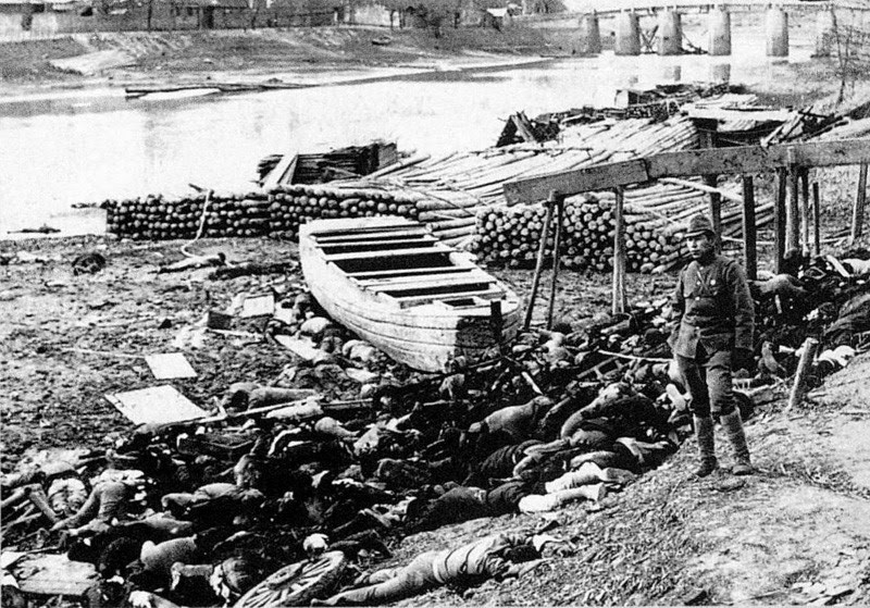 Bodies of victims along Qinhuai River out of Nanking's west gate during Nanking Massacre. (Wikimedia Commons)