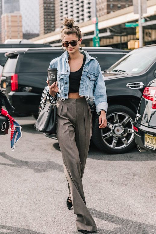 Le Fashion Blog NYFW Taylor Hill Street Style Sunglasses Cropped Denim Jacket Crop Top Wide Leg Trousers Via Collage Vintage