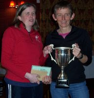 Karen accepts the cup for best female