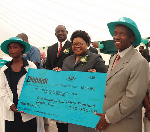 Zimbabwe Vice President Hon. J.T.R. Mujuru presenting a cheque to Never Maroka on achieving Extension Worker of the Year award sponsored by Pannar Seed Company. by Pan-African News Wire File Photos
