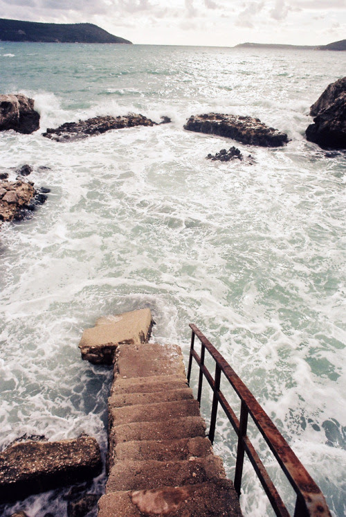 ofolodza:   Stairway to the sea. Life is delicate. Life is full of choices. One bad choice and one can be falling into the ocean without a life jacket. Choose wisely.