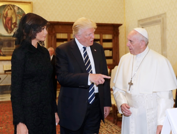 Pope Francis (R) meets with US President Donald Trump and US First Lady Melania Trump during a private audience at the Vatican on May 24, 2017. US President Donald Trump met Pope Francis at the Vatican today in a keenly-anticipated first face-to-face encounter between two world leaders who have clashed repeatedly on several issues. / AFP PHOTO / POOL / Alessandra Tarantino        (Photo credit should read ALESSANDRA TARANTINO/AFP/Getty Images)
