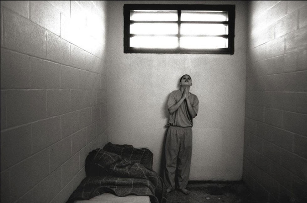 Prisoner in Cell Praying