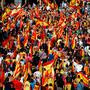 People wave Catalan and Spanish flags as they attend a pro-union demonstration organised by the Catalan Civil Society organisation in Barcelona, Spain, October 8, 2017. REUTERS/Juan Medina