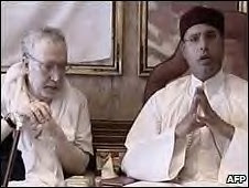 Former Libyan political prisoner Abdel Basset al-Megrahi and Seif al-Islam speaking on national television after Abdel's release from a Scottish prison. The US administration has made political attacks on Libya in the aftermath of his return. by Pan-African News Wire File Photos
