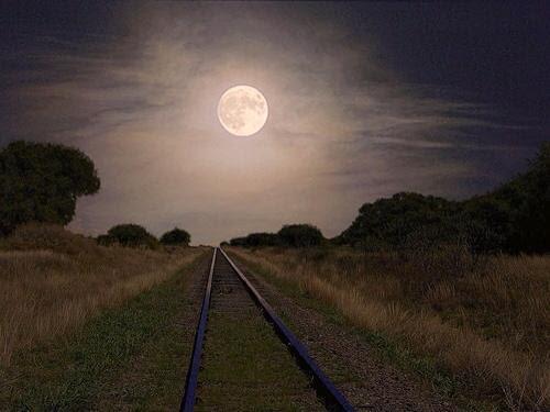 [Photo of moonlit railroad tracks]