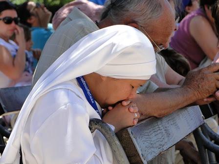 nun praying at St. James Church