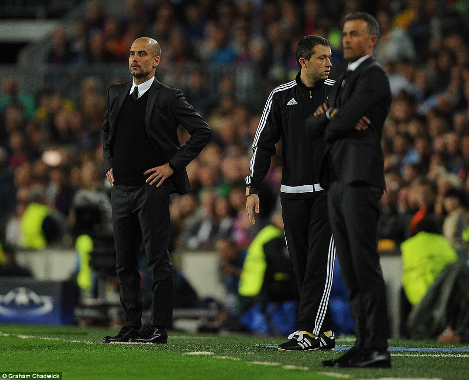 Guardiola watches on from the sidelines as the action continues to gather apace at the Nou Camp